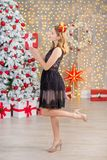 Beauty fashion woman Christmas background new year tree. Vogue style sexy girl. Gorgeous female in luxury dress at Xmas. Party. Luxury life concept. Retro style Royalty Free Stock Photo