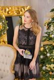 Beauty fashion woman Christmas background new year tree. Vogue style sexy girl. Gorgeous female in luxury dress at Xmas Stock Images