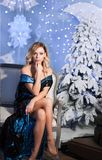 Beauty fashion woman Christmas background new year tree. Vogue style sexy girl. Gorgeous female in luxury fur at Xmas. Gorgeous female in luxury fur at Xmas Stock Photo