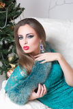 Beauty fashion woman at Christmas tree Stock Image
