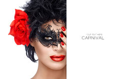 Beauty Fashion Woman with Elegant Mask. Red Lips and Manicure. Beauty model girl with stylish black carnival mask and Big Red Rose Flower. Red Lips and Manicure Stock Images