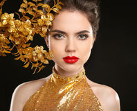 Beauty fashion woman in golden dress. Red lips. Glamour portrait Royalty Free Stock Photography