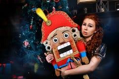 Beauty fashion woman with nutcracker Royalty Free Stock Photo