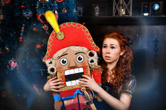 Beauty fashion woman with nutcracker Stock Photos