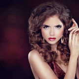 Beauty Fashion Woman Portrait. Jewelry. Wavy Hairstyle and Make- Royalty Free Stock Image