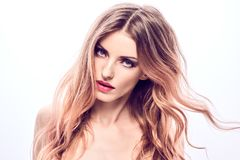 Beauty fashion woman portrait. Skin care hairstyle. Beautiful fashion woman with perfect healthy skin, trendy wavy hairstyle, fashionable makeup smiling stock photo