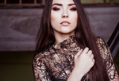 Beauty fashion woman portrait wearing black top with perfect smokey makeup.  Stock Photography