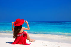 Beauty fashion woman in red hat enjoying beach relaxing joyful o Royalty Free Stock Images