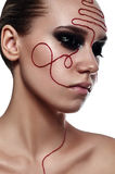 Beauty fashion Woman with red Thread on her Face Stock Images