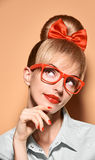 Beauty fashion woman, stylish glasses.Hipster girl. Beauty fashion woman in stylish glasses thinking, idea. Attractive pretty blonde hipster girl smiling Royalty Free Stock Photos