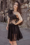 Beauty fashion woman wearing designer stylish dress in the abadoned town.  Stock Images