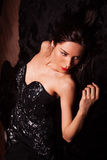 Beauty fashion Women Portrait. Model pose in luxury dress on black fur. Royalty Free Stock Photography