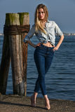Beauty fashionable blondie woman standing on the pier. Marina place. Beauty fashionable blondie woman standing on the pier Royalty Free Stock Images