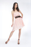 Beauty - fashionable girl in light dress standing royalty free stock photos