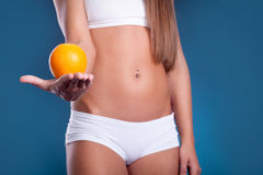 Beauty female body with orange. Healthy lifestyle concept Stock Images