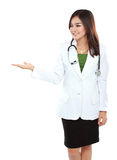 Beauty female doctor  showing blank area Stock Photography