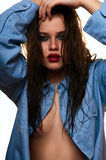 Beauty female fashion model with wet hair and blue shirt Royalty Free Stock Photo