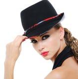 Beauty female with fashionable glamour hat. Portrait of glamour stylish luxuriant female with fashionable female hat Stock Image