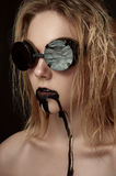 Beauty female Model with black Drips on Face Royalty Free Stock Photos