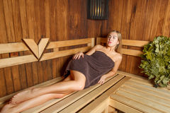 Beauty female relax in a sauna. Royalty Free Stock Photography