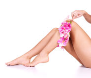 Beauty female slim legs. After depilation isolated on white Stock Photos
