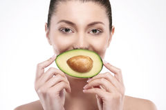 Beauty of femininity. Avocado is the best way for natural beauty Royalty Free Stock Image