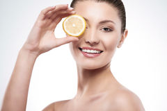 Beauty of femininity. Beautiful woman with slice of lemon Stock Images