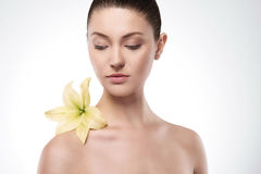 Beauty of femininity. Natural beauty of woman with flower Royalty Free Stock Photos
