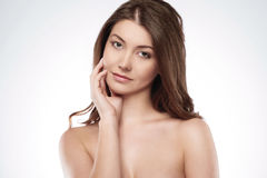 Beauty of femininity. Natural woman takes care about condition of skin Stock Images