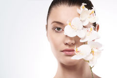 Beauty of femininity. Beauty woman with pure flower Royalty Free Stock Photography