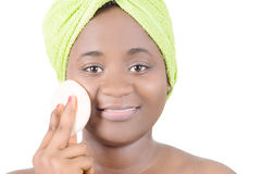 Beauty and feminity. This smiling young woman puts makeup on face royalty free stock photos