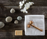 Beauty feng shui wallpaper with pebbles, flowers, towel and massager Stock Photography