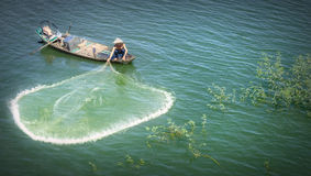 Beauty fishermen toss their nets on the river Stock Photos