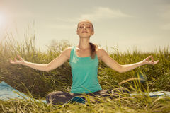 Beauty fit blond young woman meditating on the nature with eyes Stock Photo