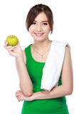 Beauty fitness woman eating fresh green apple Royalty Free Stock Photo