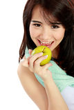 Beauty fitness woman eating fresh green apple Stock Photography