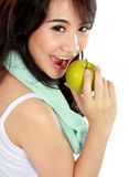 Beauty fitness woman eating fresh green apple Stock Image
