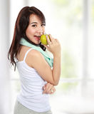 Beauty fitness woman eating fresh green apple Royalty Free Stock Image