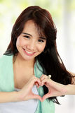 Beauty fitness woman with heart sign Stock Photo