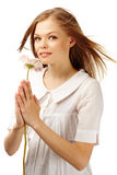 Beauty with flower. Image of fresh female holding nice herbera in hands Royalty Free Stock Photography