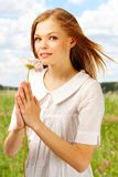 Beauty with flower. Image of fresh female holding nice herbera in hands Stock Images