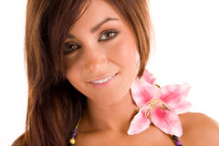 Beauty with flower. Closeup studio portrait of a beautiful, smiling young woman with a pink flower on her left shoulder. Isolated on a white background stock photography