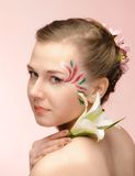 Beauty flower girl on the pink background Royalty Free Stock Photography