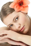 Beauty with flowers. Face of a young woman with a flower Stock Photos