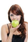 Beauty fruit. The beautiful girl eats a green apple Stock Photo