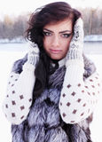 Beauty in a fur vest Stock Photos