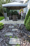 Beauty garden with wicker furniture Stock Photos