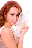 Beauty gedheaded girl with fan Stock Images