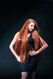 Beauty ginger Girl Portrait. Healthy Long Red Hair. Beautiful Yo Royalty Free Stock Images