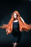Beauty ginger Girl Portrait. Healthy Long Red Hair. Beautiful Yo Stock Photo